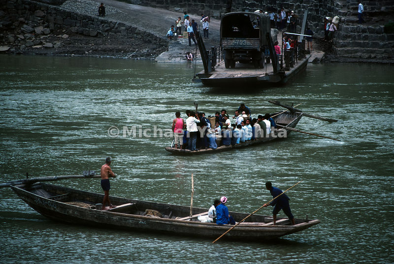 Ferry boats cross the river in Tu Chung,.Guizhou, China.