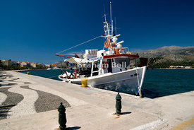 Fishing boat moored besides Cobbleston Seafront, Argostoli, Kefalonia, Ionian Islands, Greece.