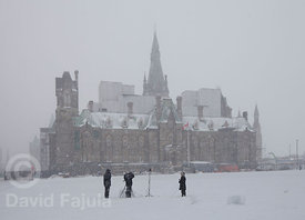 Television journalists working in front of Ottawa's Parliament