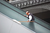 Unique jobs: man cleaning escalator