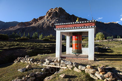 Prayer wheel in a meadow near Phyang Gompa, near Leh, Ladakh, India