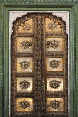 Intricate painted doorway in a courtyard in the Jaipur City Palace, Rajasthan, India
