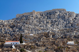 The abandoned village or Chorio and medieval castle of the Knights of St John, Chalki Island, Dodecanese Islands, Greece.