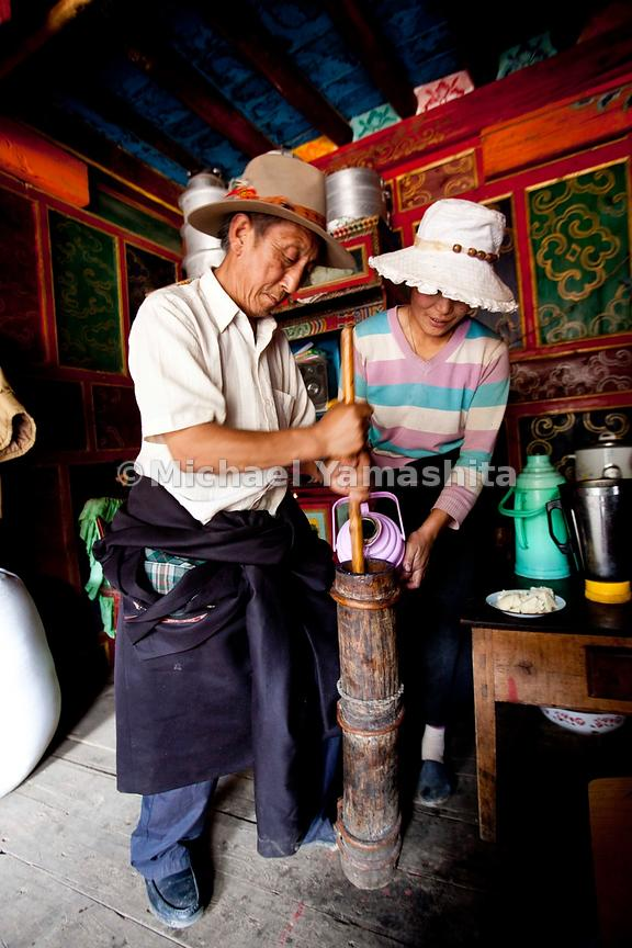 Chamagudao, Tea Horse Road, Ganze. Pics of Tsering's Family house, 7 km from the city. Small farming village, grows barley and potato, and raise horses and yaks. Tsering's father making yak butter tea......................................