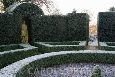 The yew hedges of the Brick Garden contain statues of English monarchs. Kingston Maurward Gardens, Dorchester. Dorset, UK