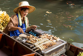 The floating market called Damnoen Saduak Floating Market in Damnoen Saduak District, Ratchaburi province, about 109 kilometers south of Bangkok.