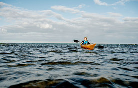 Nordic woman kayaking