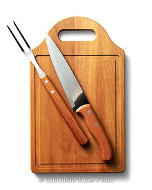 cutting board food with fork and knife