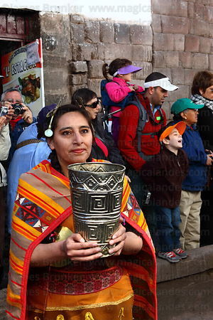 Ñusta / Virgin of the Sun holding a golden ceremonial cup called a kero during processions for Inti Raymi festival , Cusco , Peru