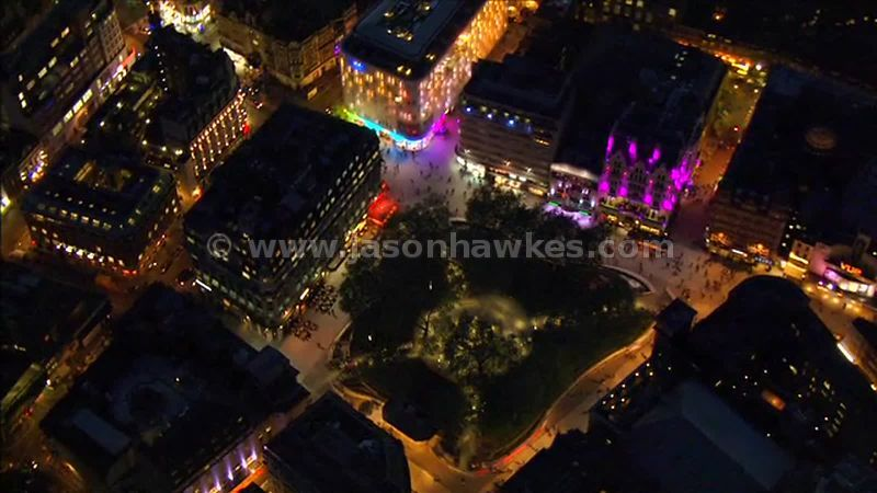 Aerial footage around Leicester Square at night, West End, London, England, UK