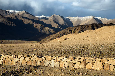 Stone wall in the Himalayan desert near Karu, Ladakh, India