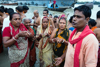 Hindus pray for deceased relatives during Mahalaya, Babughat, Kolkata, India