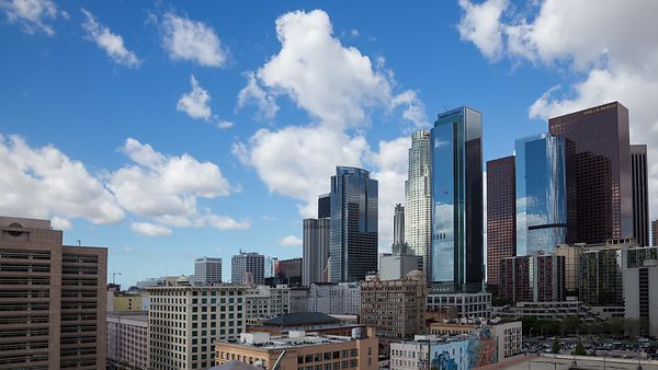 Medium Shot: Panning The Shadows Of Cumulus - Reflective Glass & Steel, Downtown L.A.
