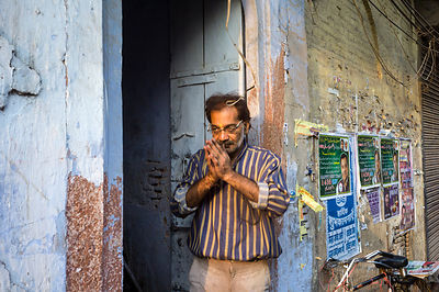 India - Delhi - A man offering prayers on the street at dawn
