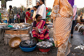 A vendor at Sassoon dock, one of the largest fish markets in Mumbai, India