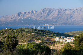 view of the village of Katomeri with the mountains of mainland Greece in the distance, Meganisi Island, Greece.