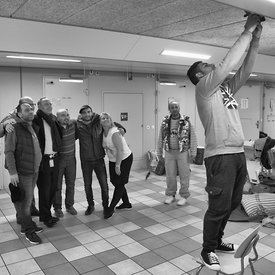 Fada Theater; a theatre group started by (Syrian) refugees. Starting small in the refugee centre in a Dutch prison, they performed in a church and after that they performed in theatres all over the country. These images show the contrast between their life in the refugee centre annex prison building and their performance on stage in the lime light. These series end with their transfer to another place, their celebration for receiving their status and the celebration of Kingsday in the Netherlands.