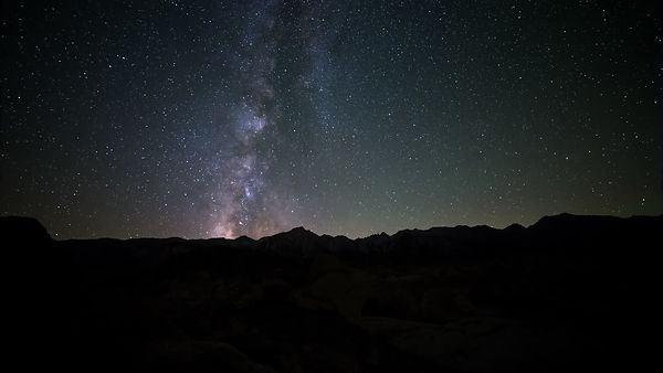 Medium Shot: Dark Sky & Milky Way Open The Horizon For An Bright Moon Strike