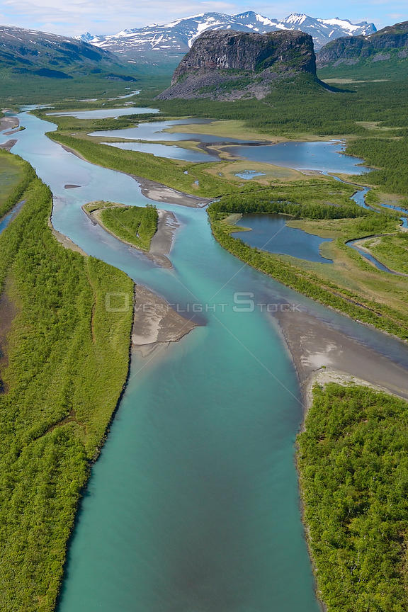 Aerial view of the Rapa river delta with distant mountains, Sarek National Park, Greater Laponia Rewilding Area, Lapland, Norrbotten, Sweden, June 2013.