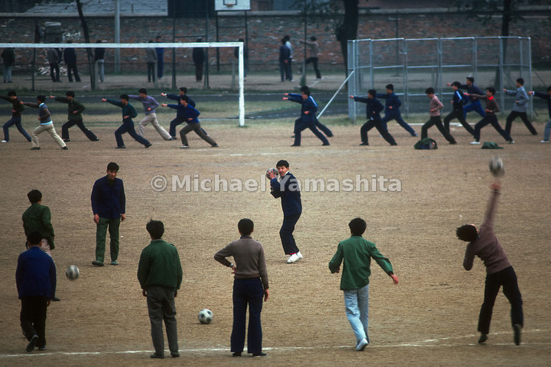 Students exercise and play soccer at Nanking University in.China.