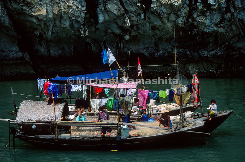 Many fishing families live on their boats..Halong Bay, Vietnam