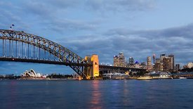 Wide Shot: The Lighting Of Sydney Opera House,  Harbor Bridge, & Skyline (Day to Night)