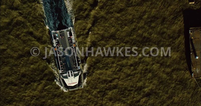 Aerial footage of London close of up boat moving west on River Thames.