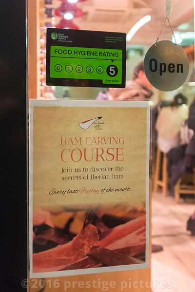 Poster in Deli WIndow for a Spanish ham carving course