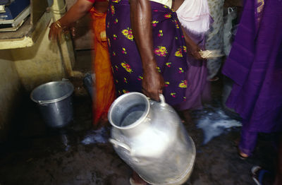 India - Kerala - women collect milk at the dairy