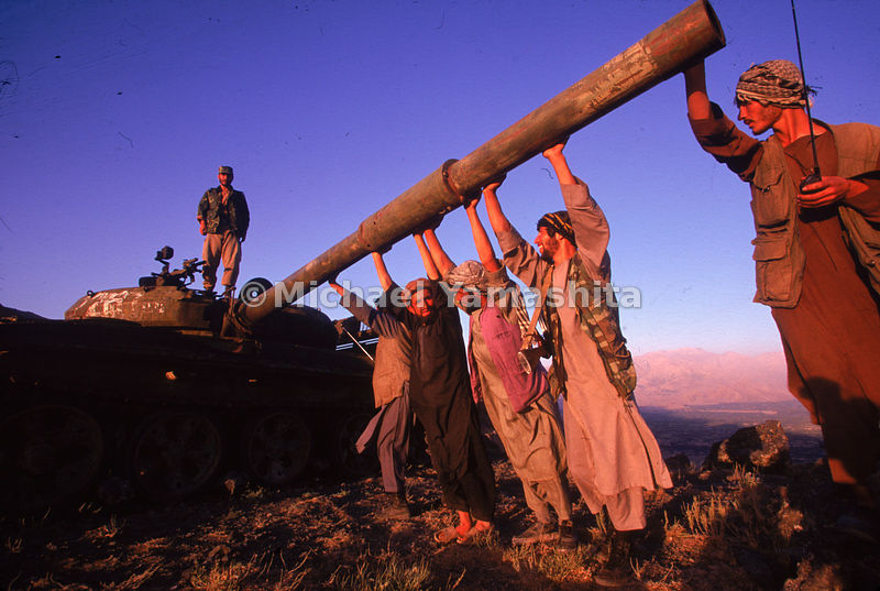 Troops loyal to Ahmad Shah Massoud, leader of the Northern Alliance, aim the cannonof an old Russian tank.