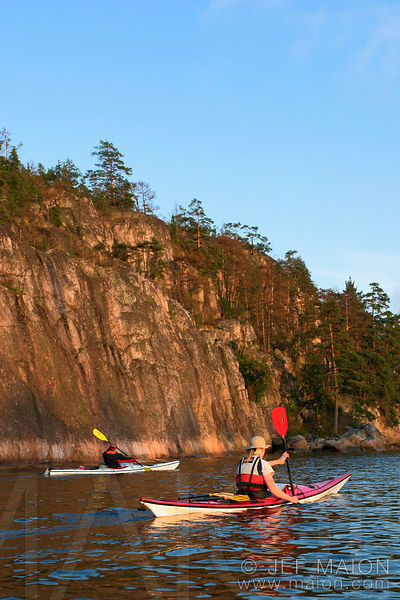 Kayaking by cliffs