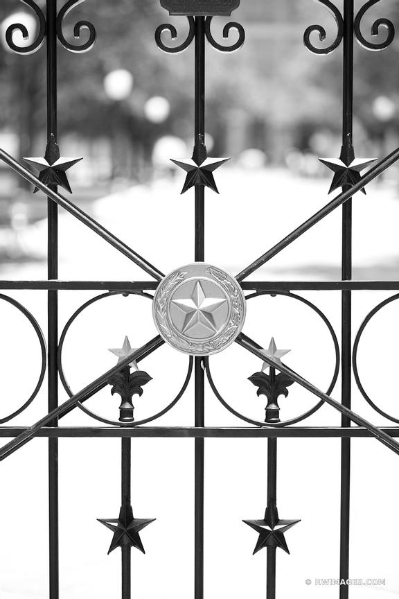 TEXAS LONE STAR IRON FENCE CAPITOL BUILDING AUSTIN TEXAS BLACK AND WHITE
