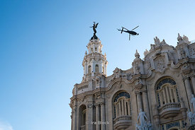 El Capitolio, or National Capitol Building in Havana, Cuba, with a helicopter filming a movie flying overhead.  It was the seat of government in Cuba until after the Cuban Revolution in 1959, and is now home to the Cuban Academy of Sciences.
