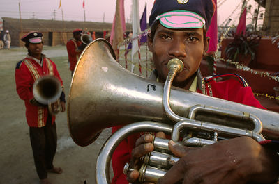 India - Allahabad - Band members practice their instruments before a parade