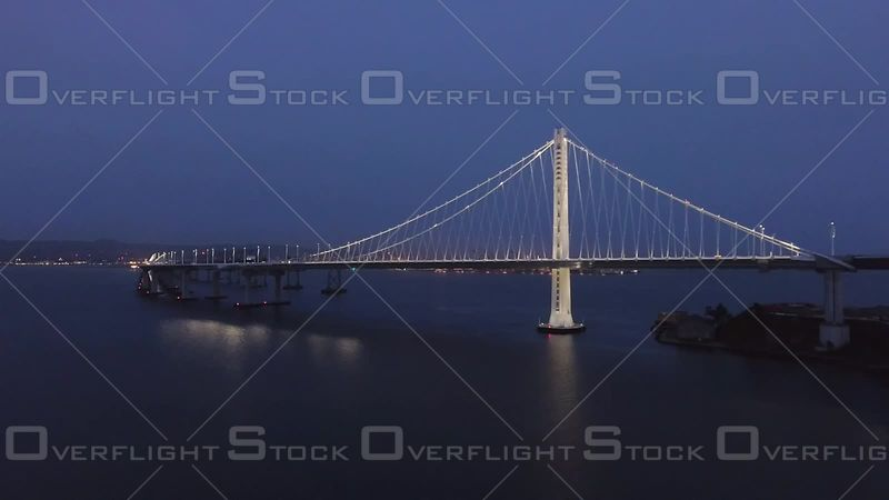 San Francisco Bay Bridge Dusk Wide Shot North Distant Side Road Level