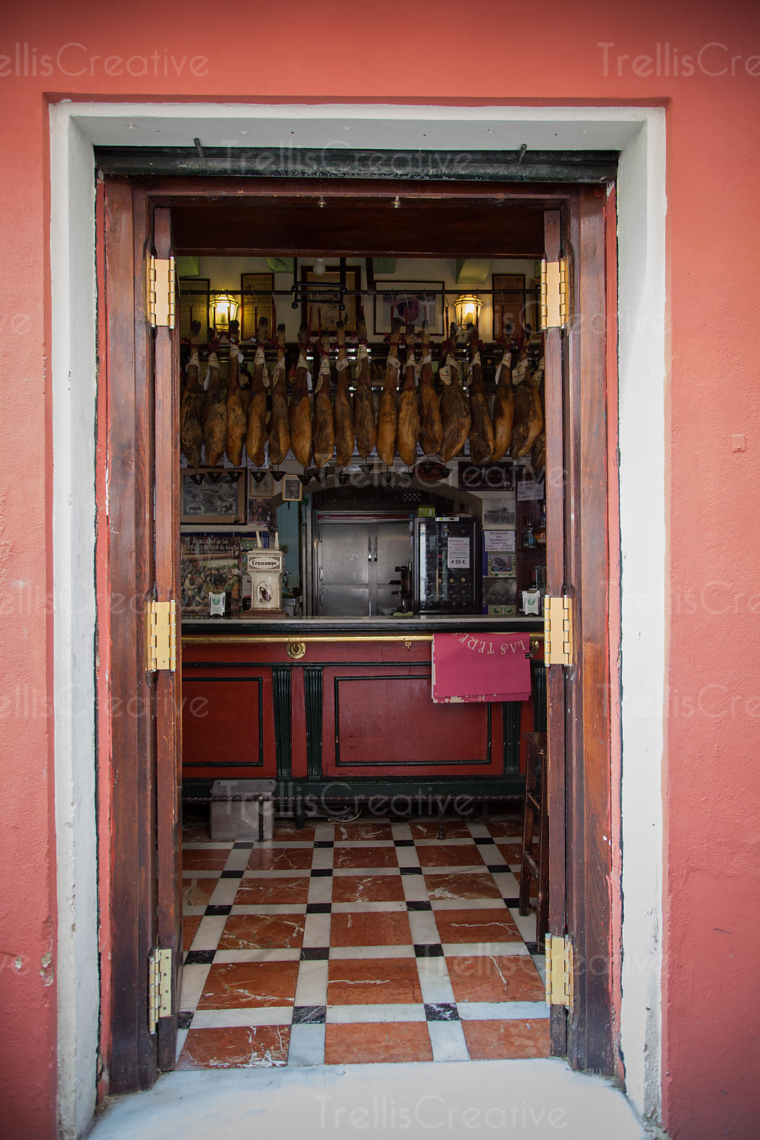 Iberico ham hanging in a tapas restaurant in Seville, Spain