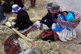 Women who have arrived with new grass ropes to rebuild the bridge wait to be registered, Q'eswachaka , Canas province , Peru