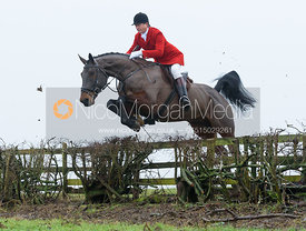 Nicholas Leeming jumping a hedge above Withcote