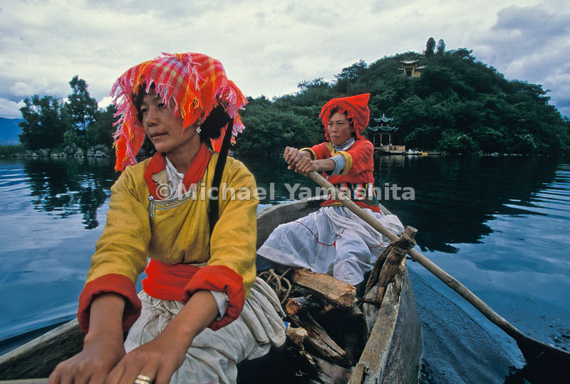 Old ways survive on Lugu Lake, where the Mosuo people wear the same traditional dress as they did during Rock's day.