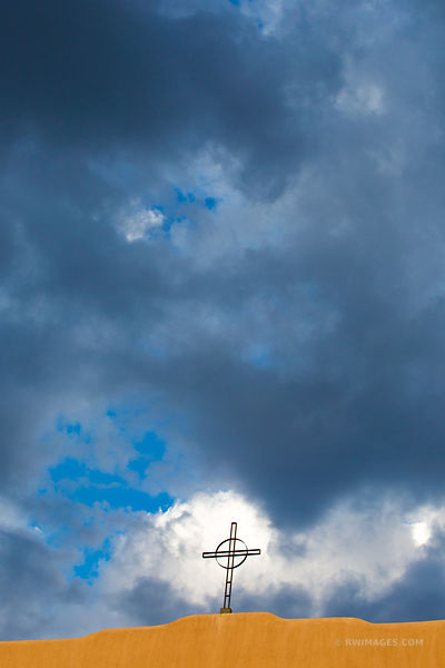 CROSS AND STORMY SKY SANTA FE NEW MEXICO ARCHITECTURE COLOR VERTICAL