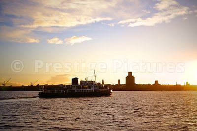 The Royal Iris of the Mersey Ferry on the Water at Sunset