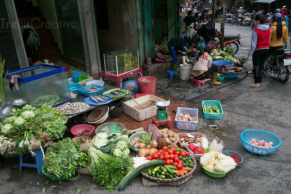 vegetables being sold on the street corner