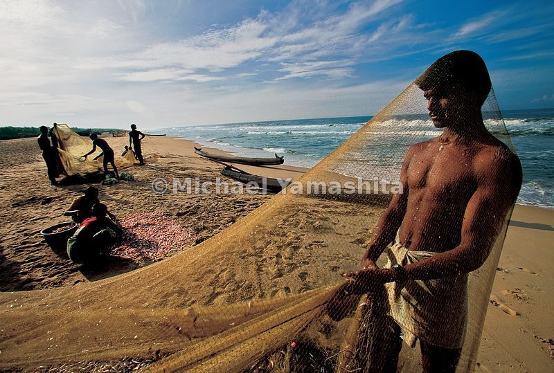 Scales sparkle like jewels, as fishermen clean their nets on Somatheeram Beach, just as when Zheng He sailed along the Malabar Coast.