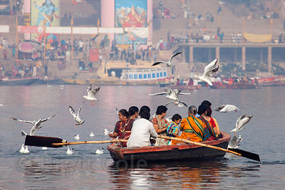 Hindu pilgrims ride in a boat on the Ganges River, Varanasi, India.