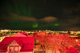 The Aurora Borealis or Northern Lights in the sky over Reykjavik, Iceland.
