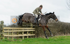Bruce Langley-McKim jumping a hunt jump on the Quenby Estate