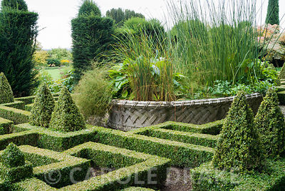 Basket pond at the centre of the Knot Garden came from the 1851 Great Exhibition. Bourton House, Bourton-on-the-Hill, Moreton-in-Marsh, Glos, UK