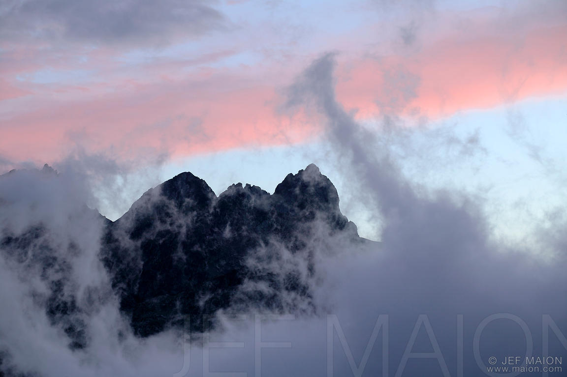 Peak and rising mist at dusk