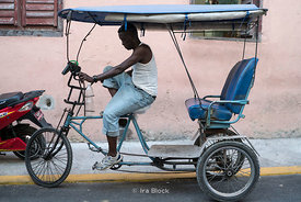 A  cycle rickshaw or bicitaxi in Havana, Cuba.