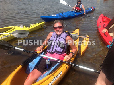 Young woman using an adaptive kayak